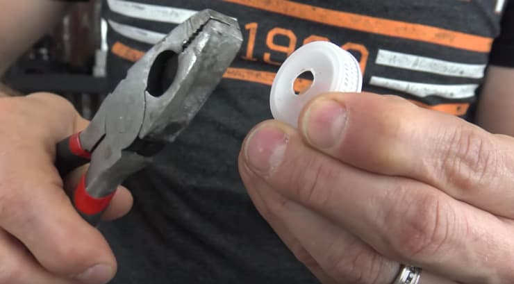Use a pair of pliers to clean out any excess for the hole